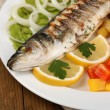 Delicious grilled fish on plate on table close-up — Stock Photo