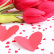 Paper hearts with flowers on bright background — Stock Photo