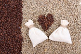 Sacks with coffee on coffee beans background — Stock Photo