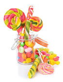 Different colorful fruit candy in jar isolated on white — Stock Photo