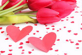 Paper hearts with flowers on bright background — Stockfoto
