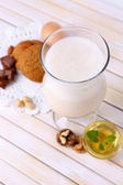 Eggnog with cookies on wooden table — Stock Photo