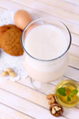 Eggnog with cookies on wooden table — Stock fotografie