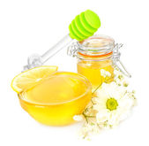 Sweet honey with lemon isolated on white — Stockfoto
