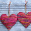 Stock Photo: Decorative hearts on wooden background