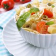 Delicious pasta with tomatoes on plate on table close-up — Stock Photo #41764423