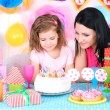 Pretty little girl with mom celebrate her birthday — Stock Photo #41765245
