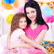 Pretty little girl with mom celebrate her birthday — Stock Photo #41765421