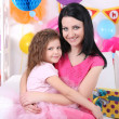 Pretty little girl with mom celebrate her birthday — Stock Photo