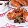 Fresh baked pasties with cherry on plate on table close-up — Stock Photo #41765545
