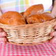 Fresh baked pasties with berries in wicker basket close-up — Stock Photo
