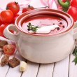 Stock Photo: Tasty tomato soup and vegetables on wooden table