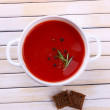 Stock Photo: Tasty tomato soup on wooden table