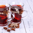 Stock Photo: Mulled wine with spices on wooden background