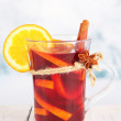 Stock Photo: Mulled wine with orange and spices on table on bright background