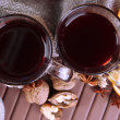 Stock Photo: Mulled wine with orange and nuts on table close up