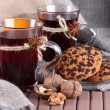 Stock Photo: Mulled wine with oranges and cookies on table on fabric background