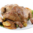 Whole roasted chicken with vegetables on plate, isolated on white — Stock Photo #41768143