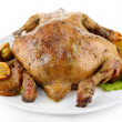 Whole roasted chicken with vegetables on plate, isolated on white — Stock Photo #41768145