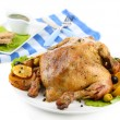 Composition with Whole roasted chicken with vegetables, color napkin, on plate, isolated on white — Stock Photo #41768157