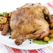 Stock Photo: Composition with Whole roasted chicken with vegetables, color napkin, on plate, isolated on white