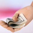 Stock Photo: Money in wooden hand, on light background