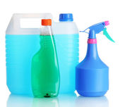 Canister with liquid and detergent bottles isolated on white — Stock Photo