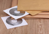 Envelopes with top secret stamp with CD disks close-up on wooden background — Stock Photo