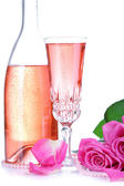 Composition with pink sparkle wine in glass, bottle and pink roses isolated on white — Stock Photo