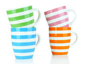 Color empty mugs isolated on white — Stock Photo