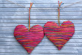 Decorative hearts on wooden background — Stock Photo