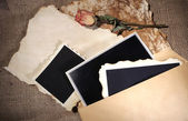 Composition with blank old photos, paper, letters on sackcloth background — Stockfoto