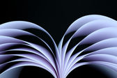 Abstract image of sheets white paper wave shape on black background close-up — Stok fotoğraf