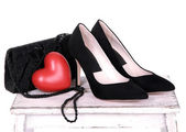 Beautiful black female shoes and bag on white background — Stock Photo