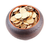 Golden coins in ceramic pot, isolated on white background — Stock Photo