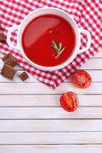 Tasty tomato soup on wooden table — Stock Photo