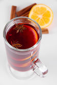 Mulled wine with lemon and spices close up — Stock Photo