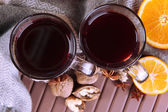 Mulled wine with orange and nuts on table close up — Stock Photo