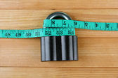 Conceptual photo of unlocking  secret of weight loss. On color wooden background — Stock Photo