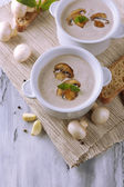 Mushroom soup in white pots, on napkin,  on wooden background — Stock Photo