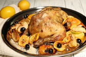 Whole roasted chicken with vegetables on tray, on wooden background — Stock Photo
