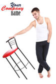 Handsome young man with chair isolated on white — Stock Photo