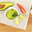 Stock Photo: Fresh guacamole in bowl on table