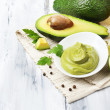 Stock Photo: Fresh guacamole in bowl on wooden table
