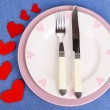 Valentines day dinner with table setting on blue background — Stock Photo