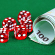Stock Photo: Red dices and money, on green background
