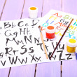 Stock Photo: Alphabet watercolors on wooden background