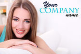 Young woman resting on sofa at home — Stock Photo