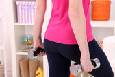 Young beautiful fitness girl exercising  at home, close up — Stockfoto