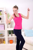 Young beautiful fitness girl exercising  at home — Stock Photo